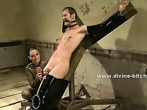 Strong male slave with huge muscles immobilized in ropes and cuffs by gang of...