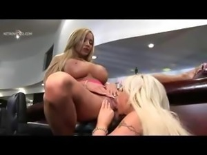 Busty pornstars Candy Mason and Lexxxi tongue fucking their pussies