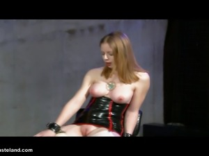 A FemDom plays with Her female slave with some new toys.