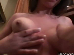Pornstar gets naked and masturbates
