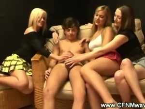 Clothed teenage girls give boy his first handjob