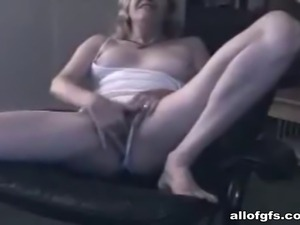 Blonde chick masturbates on the chair