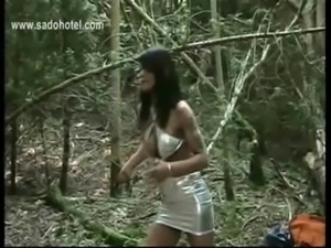 Dirty slave tied to a tree is hit very hard with a whip by horny mistress free