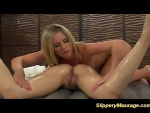 Slippery massage with lesbian babes dildoing pussy