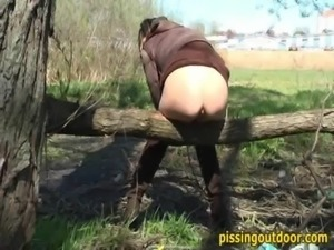 Pissing autumn girl free