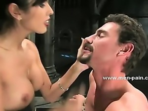 Extremly horny mistress with big tits spanking man and torturing him in...