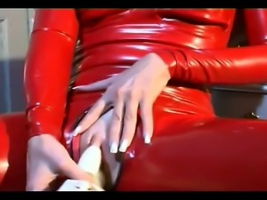 Amazing tied up slave girl in red latex bends over and shows off her sexy ass
