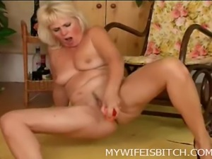 Naughty naked mature playing with shaved pussy on the rocking chair