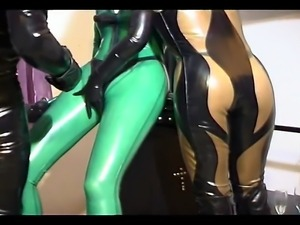 Dominant couple in latex outfit enjoys taking care of their slave girl