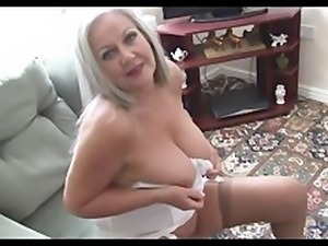 Busty attractive granny in open girdle and stockings