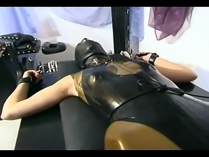 Delicious slave girl in latex mask gets tied up on the bench by her master