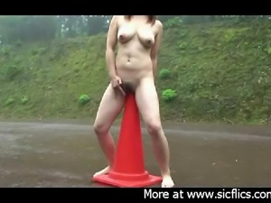 Extreme amateur slut fucks a huge traffic cone in the middle of a street