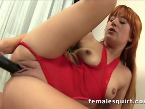 Cute redhead Lucy Bell rubs and stuffs a dildo into her tight pussy until she...