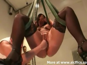 Kinky amateur slut is suspended in a swing and fist fucked in her loose cunt...