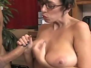 Big breasted mom strokes a black cock
