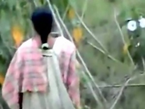 Village women sitting out for twos