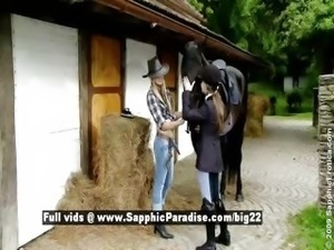 Aneta and Mya from sapphic erotica lesbo girls have lesbo kissing near a horse