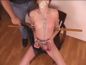 Redhead milf bound with rope and her undies pushed in her mouth