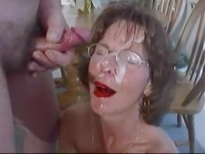 Mature brunette in glasses cherishes huge facial cumshot.