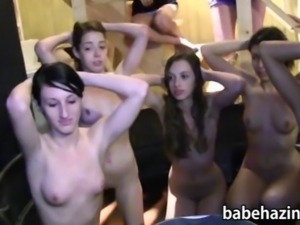 Group of newbie pledges strip down on a big tub and dyke out