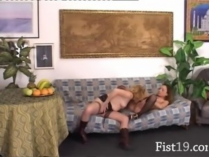 Babes inserting fists into their pussies