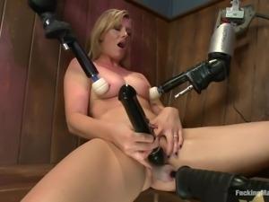 blonde milf pleasuring herself on a table