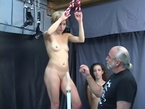 Bound blonde rides pole while man and brunette watching