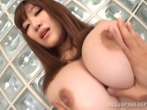 playing with a pair of huge asian boobs