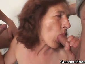 Busty brunette mature gets banged by young studs