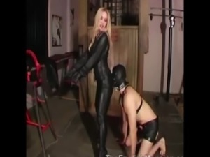Prodomme pulls off her hooded slaves cock free