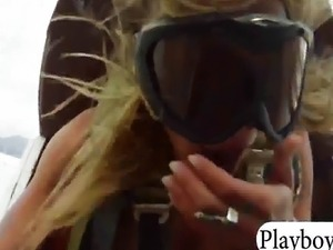 Sexy playmates try out driving a biplane