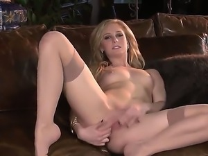 Blonde milf Tatum Woods in sexy stockings is having a one of a kind solo...