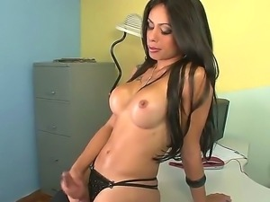 Hot and tanned shemale Bruna shows her amazing boobs and sweet dick