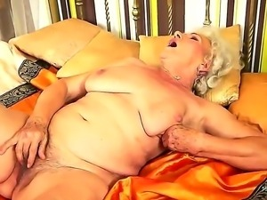 Granny with extremely hairy pussy named Norma rubs it with a new toy in the...