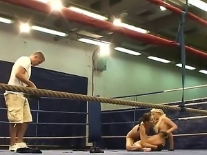 Behind the scenes footage with lesbian fighters Aspen and Blond Cat on the ring