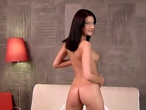 Teen brunette Milla Yul with medium round boobs takes off her clothes and...