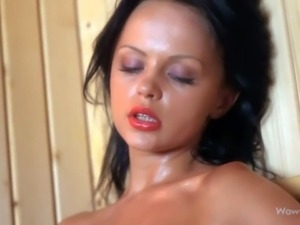 Petite young sauna girl Melanie B is naked, wet and