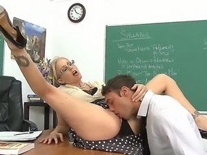 Julia Ann remains alone with Rocco Reed in the classroom and presents him a...