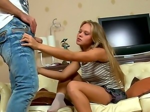 The amazing blonde schoolgirl Amelia makes a footjob to her boyfriend while...