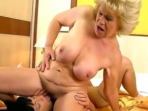 Mature blonde woman with hairy pussy Brenda gets it licked by young brunette...