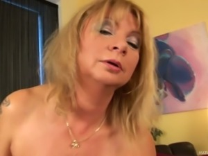 Mature woman Rosalyn with wet biog natural tits takes off
