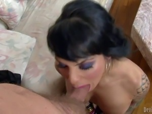 Topless transsexual brunette TS Foxxy in mesh pantyhose exposes her