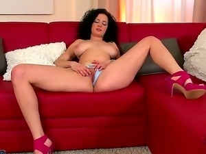 Curly haired brunette Miley Smiley with large natural boobs masturbates on...