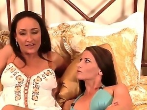 Two very hot mature lesbians are lying in the bed and are going to start petting
