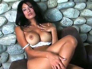 Steaming Jasmine Foxx shows off in front of a cam exposing her huge knockers...
