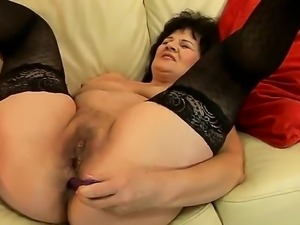Sweet granny Helena May is getting her cunt and anal tunnel pleasured with...