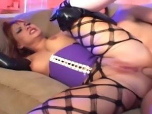 Pretty redhead fucking in fencenet pantyhose a corset and latex gloves