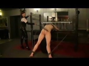 Nasty mistress dealing some pain to a male slave who has been naughty