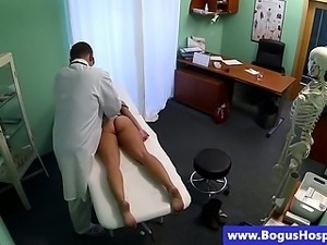 Doctor checks up his blonde patient