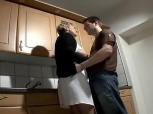 Nice looking granny romps in the kitchen.